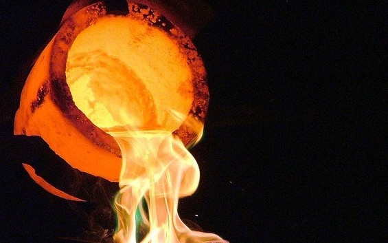 Pouring liquid gold from a crucible